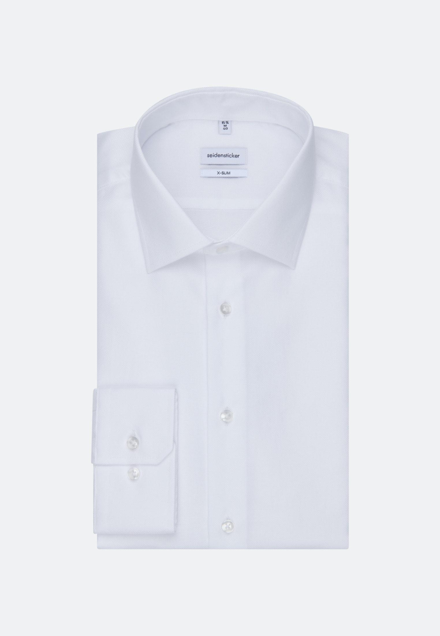Artikel klicken und genauer betrachten! - Dieses X-Slim Herren-Hemd von Seidensticker kommt mit zeitlosem Business Kent-Kragen und extra langem Arm. Der besonders schmale, körpernahe Schnitt betont die Silhouette. Die unifarbene Struktur-Baumwolle verleiht besten Tragekomfort und eine griffige Haptik. Der bügelfreie Stoff wurde in einem aufwendigen Verfahren so behandelt, dass er sich nach dem Waschen wieder in Form zieht.   im Online Shop kaufen