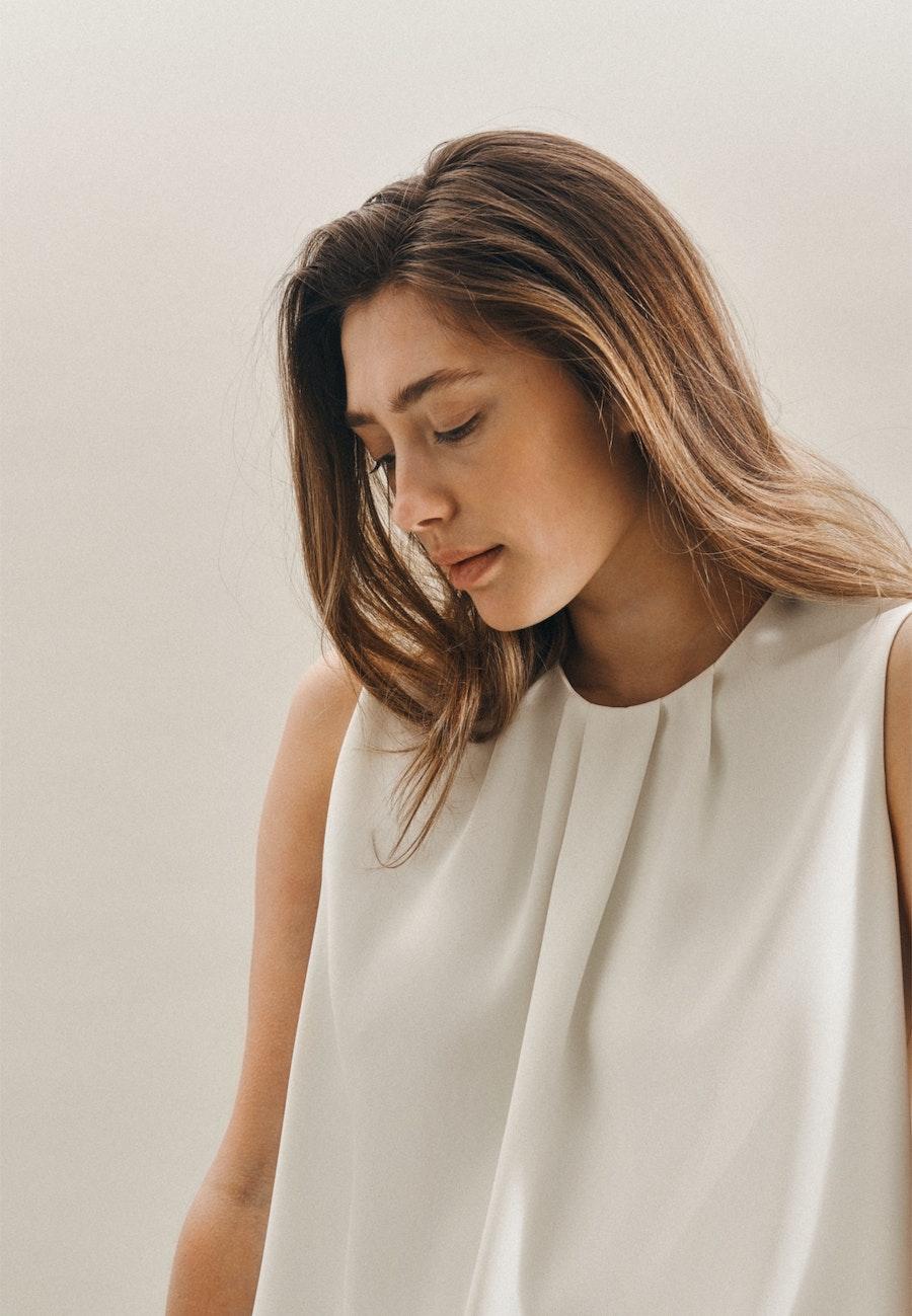 Ärmellose Krepp Shirtbluse aus 100% Polyester in Ecru    Seidensticker Onlineshop